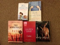 """Picture of the books: """"It Had to Be You"""" by Jill Shalvis, """"Dark Secret Love: A Story of Submission"""" by Alison Tyler, """"Duty & Desire: Military Erotic Romance"""" edited by Kristina Wright, """"Cake"""" by Lauren Dane, and """"The Arrivals"""" by Melissa Marr."""