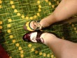 Picture of shoes that Jennifer Lohmann and Kelly Maher were wearing at RT 2014. Both are Mary Jane style heels where Kelly's are wine patent leather with a thin leather cord tying off the arch strap, and Jennifer's are multi-colored spectators of taupe, yellow, and green with a taupe ribbon tying off the arch strap.
