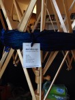 Yarn of various blue colors on a yarn holder. Tag identifies it as Malabrigo Worsted. The colorway is Whales Road.